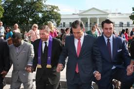 Men praying in Washington DC
